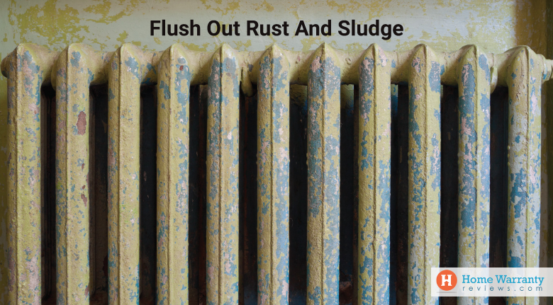 Flush out rust and sludge